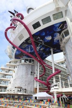 Harmony of the Seas | Become blown away when you witness the massive Ultimate Abyss slide, which amasses to 10 stories, earning the title of largest slide at sea.