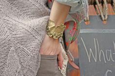 mosaic cuff with raw emeralds embedded in brass
