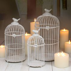 Bird cages and candles make a sweet warm fall decoration.