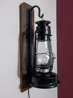 Rustic electric lantern wall sconce.