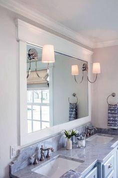 Pretty bath with framed mirror.