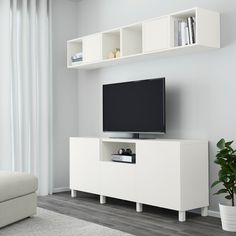BESTÅ / EKET white/dark grey, light grey, Cabinet combination for TV, 70 cm. Hide or display your things by combining open and closed storage. The drawer runner makes the drawer close silently and softly. Royal Furniture, Furniture Logo, Furniture Design, Condo Furniture, Media Storage Unit, Tv Storage, Record Storage, Living Tv, Ikea Living Room