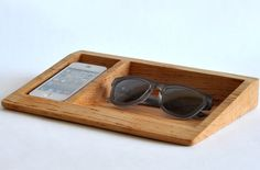 Made with Maple or Walnut wood, the Bushakan Dock is a safe place to keep your iPhone, glasses, spare change, jewelry or other miscellaneous personal items. Found at dodocase.com.
