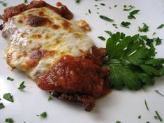 Veal cutlet Parmesan is an Italian restaurant staple, my version spices it up a little by adding the heat of red pepper flakes to traditional marinara sauce. Notice this version is not layered as most homemade versions but is made restaurant style (single scaloppini topped with sauce, Parmesan, and Provolone rather than mozzarella).