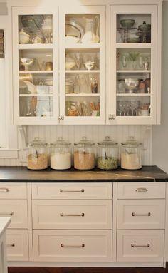 Beadboard kitchen backsplash, black counters