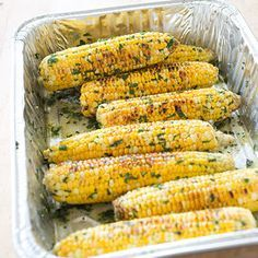 Grilled Corn with Flavored Butter Serves 4 to 6  Use a disposable aluminum roasting pan that is at least 2¾ inches deep.      1 recipe flavored butter (see related content)     1 (13 by 9-inch) disposable aluminum roasting pan     8 ears corn, husks and silk removed     2 tablespoons vegetable oil     Salt and pepper  1. Place flavored butter in disposable pan. Brush corn evenly with oil and season with salt and pepper to taste.  2. Grill corn over hot fire, turning occasionally, until…