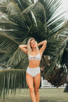 SHOP 2018 TRENDY SWIMS! Cream with pinstripes in varying shades of blue and a bow, make this swimsuit top a chic and timeless piece to add to your swim collection! With more coverage than a bikini, this suit gives you the coverage and confidence you need to be carefree. Adjustable straps allow this suit to move with you and achieve the perfect fit. Paired here with the High Seas High-Waisted Bottoms. Great for moms and for large chests! #swimsuit #swimwear #swim #summer #bikini