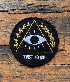 Trust no one. Deny everything. The truth is out there. Everything dies. Theyre watching. For those who want to believe. This is a high quality embroidered patch with iron-on backing with black, white and metallic gold thread. Iron it on, or sew it on - its up to you! Slap em on your jacket,