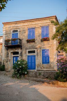 Old Aegean Arch in Turkey - Adatepe village, a house with blue windows by Ozan Özdil on 500px - Canakkalé, Turkey.