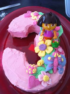 Dora cake. I like this! I'm all about the stick a plastic figure on top simplicity but this design is nice anyway. Too bad it wouldn't be half enough for our guests.