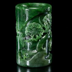 Chinese. A finely carved spinach jade brush pot of cylindrical form with high relief figural landscape; ht. 3.75 in.