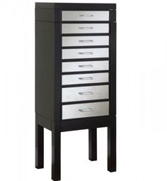 http://103rdavenue.com/jewelry-armoire-with-mirrored-drawer-fronts-in-black/ 528-314 Accent any room with this mirrored jewelry armoire. This piece is perfect for storing all of your bits and baubles. Thick, straight lined legs finish off the piece. Features: -Black finish. -Mirrored drawer fronts and silver pull. -Ample storage space. -Flip top with mirror inset, side storage cabinets and deep storage drawers. -Thick, straight lined legs. -Great...