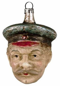 Man's head wearing a captain hat, glass Christmas ornament