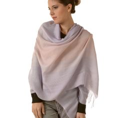 This stunning, fashion-forward wrap maintains your style while keeping you warm. Baby alpaca and silk combine to create a heavenly effect: https://www.thealpacagroupnw.com/product/bohemian-scarfshawl-nbe-07