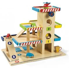 """""""Janod - Wooden Garage & Accessories""""  This would be extremely fun for my little boy who loves to pretend to refuel his race cars and roll them down pretend ramps!  #Entropywishlist #pintowin"""
