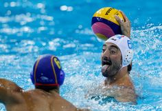 Italy's Maurizio Felugo (right) tries to score a goal as Spain's Marc Minguell defends during a match for the men's water polo competition at the FINA Swimming World Championships in Shanghai on July 26, 2011.
