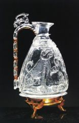 CHAPTER 8 (fig. 135, p. 253): Rock crystal ewer made for the Fatimid caliph al-Aziz. Time: 975. Location: Venice. Material: rock crystal. Significance: One of the few Fatimid court objects to survive. The pear-shaped body is decorated with a motif flanked by seated leopards carved into it with an inscription above that invokes blessing on the Fatimid caliph al-Aziz.