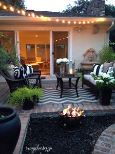 Bring the indoors, out! Extend your living area to your patio with cozy seating, using accessories that you would use inside the house.  Add greenery in planters of the same color for a cohesive look.  A string of cafe lights will highlight your space and create a beautiful ambiance.  HomeGoods Sponsored Pin.