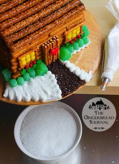 gingerbread house log cabin-free tutorial - make this from a pre-bake kit and pretzels! www.gingerbreadjournal.com