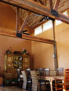 Interior dining area of barn-styled party home designed by Sentient Architecture, LLC