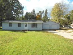 #5031 NAVAJO TRAIL. Harrison, MI. Nice 3Bdrm. Home with vinyl siding, utility, pellet stove, deck, shed, att. 28x32 Garage,  nice lot just off blacktop near state land & trails. Only $54,900.   MLS 161774