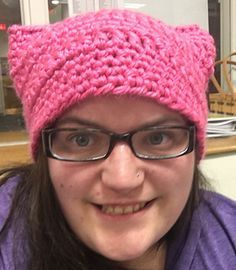 "This is a pattern for a pink ""Pussy hat"" that should fit a standard woman's head. You could easily adjust the amount of chains in the first row to fit any size head."