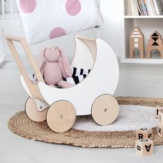 This awesome toy pram is definitely going on the holiday gift list for the kids. A little wooden pram for all of the favourite dolls