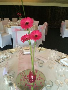Simple table vases in hot pink gerbera at hogarths hotel solihull