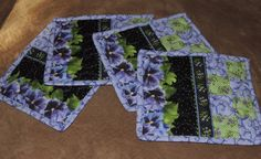 A personal favorite from my Etsy shop https://www.etsy.com/listing/254466167/purple-pansies-mug-rugs-green-black