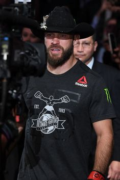 Donald Cerrone enters the arena prior to facing Mike Perry in their welterweight bout during the UFC Fight Night event inside Pepsi Center on November 2018 in Denver, Colorado. Get premium, high resolution news photos at Getty Images Bald Men Style, Mike Perry, Pepsi Center, Ufc Fight Night, Mma Training, Ufc Fighters, Nhl Jerseys, Mixed Martial Arts, Boxing
