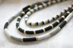 formal jewellery, party necklace, evening necklace, statement necklace Extremely beautiful, multi-strand necklace, inspired by The Great Gatsby style jewelry - made in bead crochet technique. Ive used high quality Japanese beads in black, golden, grey and white colors. The necklace