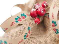 Christmas Holly and berries design. A vintage style ribbon on a natural and rustic taffeta base