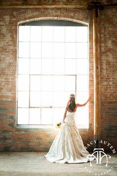 McKinney Cotton mill bridal portraits, bride, white dress, large window, old building photos  http://tracyautem.com
