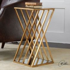 The Uttermost Janina Gold Dimensional Accent Table features angled legs finished in gold leaf that gives it a three-dimensional look along with luxe. Welded Furniture, Iron Furniture, Steel Furniture, Unique Furniture, Table Furniture, Furniture Design, Geometric Furniture, Rustic Furniture, Office Furniture