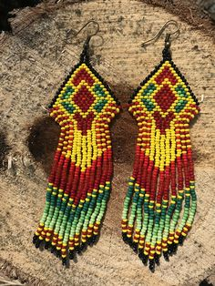 ong Earrings in Native America Style made in Yellow, Red, Light Green, Black and Green colors. Beaded out of Czech seed beads with geometrical native patterns. Color and size can be changed! When ordering and you wish a change on the color or design, feel free to write me a short