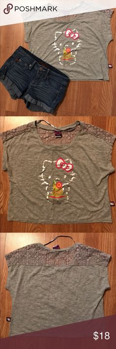 Hello kitty crop top NWOT super cute crop top, lacey on the upper back of the shirt, in great condition Hello Kitty Tops Crop Tops