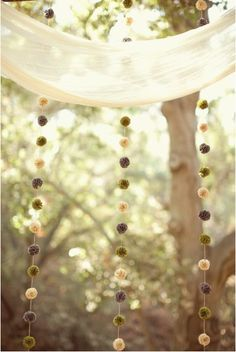 Poms are everywhere! I've never seem them look so delicate and elegant though. #poms #decoration #wedding #garland