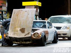 240Z  all rat rodded out. Brilliant....