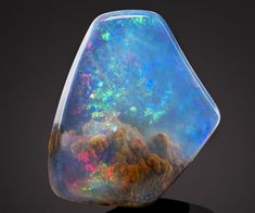 "Incredible space stone seems like it has a nebula trapped inside The stone is an opal. A ""very fine American contraluz opal found"" in Opal Butte, Oregon, according to Bonhams Minerals And Gemstones, Rocks And Minerals, Beautiful Rocks, Beautiful Dream, Absolutely Gorgeous, Beautiful Places, Mineral Stone, Rocks And Gems, Quartz Crystal"