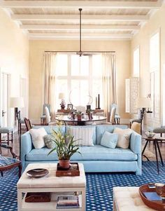 To make the vast double-height living room of this Vero Beach, Florida, house more intimate, designer  Tom Scheerer  broke it down into three seating groups and a dining area. Lacy carved shutters made in India filter the light.   - HouseBeautiful.com
