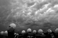 Dark clouds hang over the field during a football game at Covington Middle School on Sept. 27. The game was cancelled at halftime due to lightning. Photo by Jay Janner/Austin American-Statesman