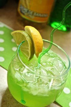 Tropic Tango: Light Rum, Melon Liqueur, Creme de Banana, Peach Schnapps, Sweet and Sour, Lime, Lemon Slice.