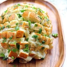 Garlic Parmesan Pull-Apart Bread—bread infused with butter, garlic, herbs, and cheese. What's not to love?