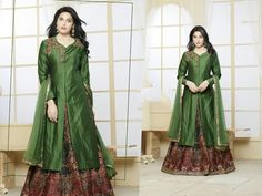 Be the dazzling diva clad in this green color silk embroidered suit with digital print. This pretty attire is showing some brilliant embroidery work.