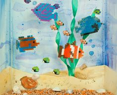 Create your own fantasy aquarium with these exotic looking fish. Decorate your aquarium with other Perler undersea designs, and add stickers and real sand if you like. Make it a family project!