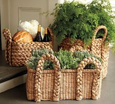 LOVE the texture of the baskets with this greenery. Pumpkins would be great in this mix!
