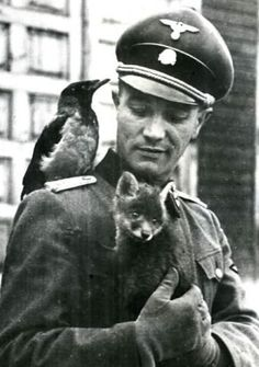 historicaltimes:  Waffen SS Major Otto Kumm playing with some animals, c. 1941