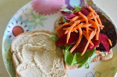 Beet Sandwich with Casher Ginger Sauce Tomato Cucumber Spinach/Mixed Greens Beets - thinly sliced and uncooked Carrots Cashew Ginger Sauce