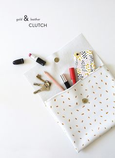 DIY essential gold & leather clutch: Photography : The Lovely Drawer Read More on SMP: http://www.stylemepretty.com/living/2016/02/15/diy-gold-and-leather-clutch/