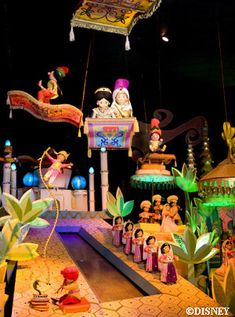 New and revamped at DisneyLAND-It's a Small World with 29 Disney characters now weaved into the ride. Here is Jasmine and Alladin.  (credit: land.allears.net)